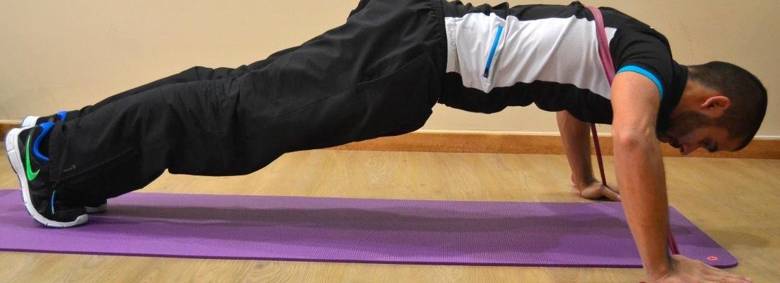 Ejercicio con bandas elásticas - Flexiones de brazo